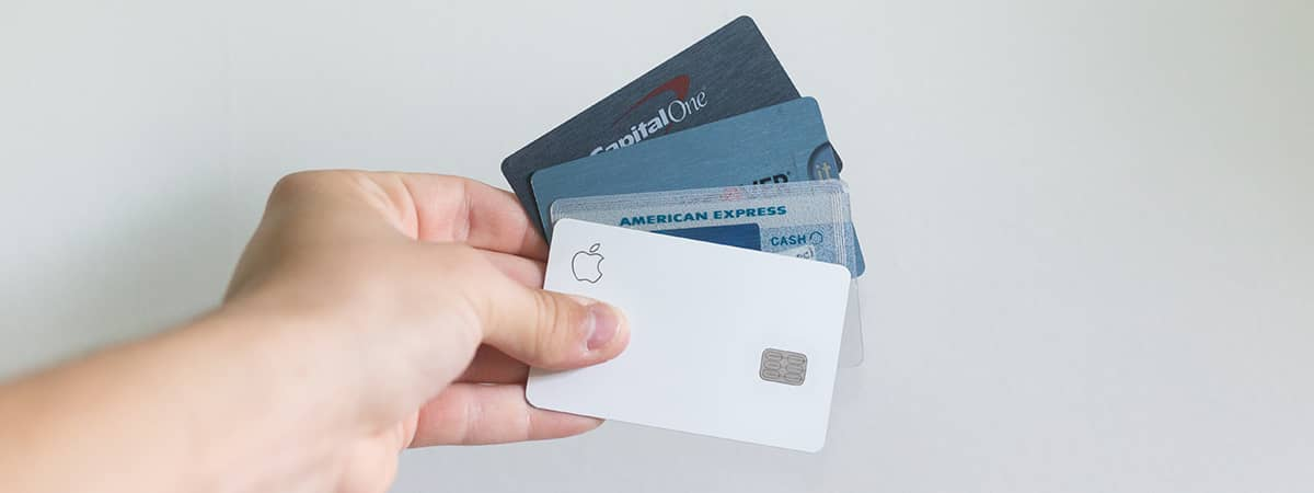 credit cards. A photo of a person holding multiple credit cards.