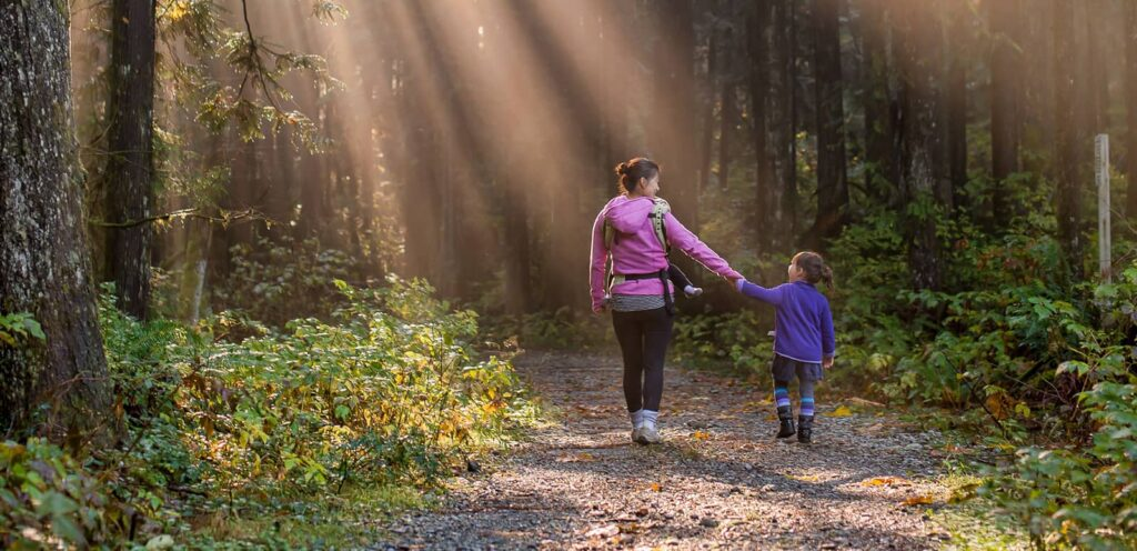 family fitness. a mother and daughter on a hike'