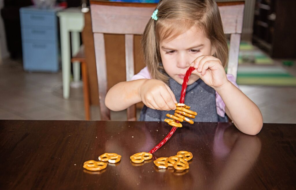 licorice lacing, an edible busy bag with licorice ropes and pretzels.