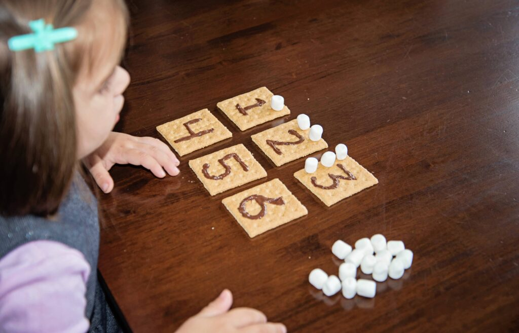 smores counting, an edible busy bag with graham crackers, chocolate and marshmallows