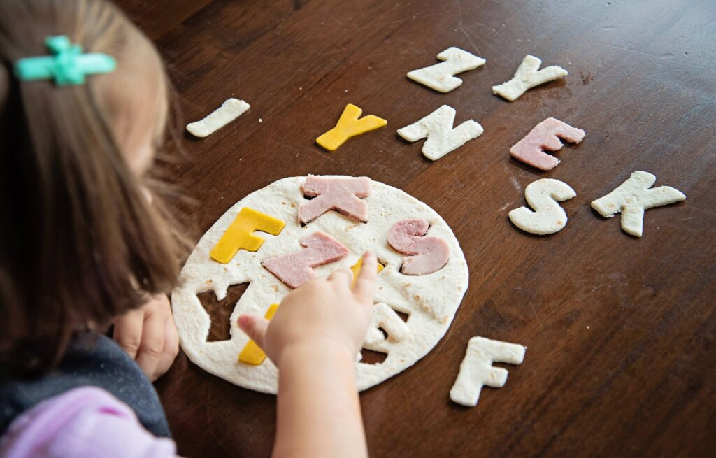 tortilla puzzle, an edible busy bag with tortillas, ham and cheese.